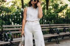 a white sleeveless crochet top, white wideleg pants, nude block heels, a neutral hat and a bag