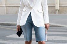 a white top, a white blazer, blue denim Bermuda shorts, blue strappy sandals and a clutch