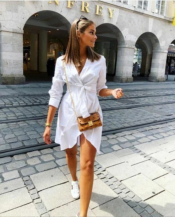a white wrap shirtdress, white sneakers, a brown crossbody for a simple and very girlish look