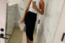 a wihte sleeveless bodysuit, a black pencil midi, white square toe heels and a grey bag to make a fresh take on a traditional combo