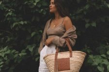 03 a taupe crop top and a mini cardigan, white linen shorts and a straw tote are a lovely idea for a vacation