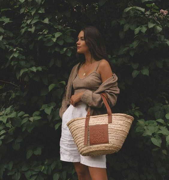 a taupe crop top and a mini cardigan, white linen shorts and a straw tote are a lovely idea for a vacation