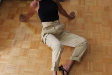 04 a black halter neckline top, tan paperbag waist trousers and black heeled flipflops
