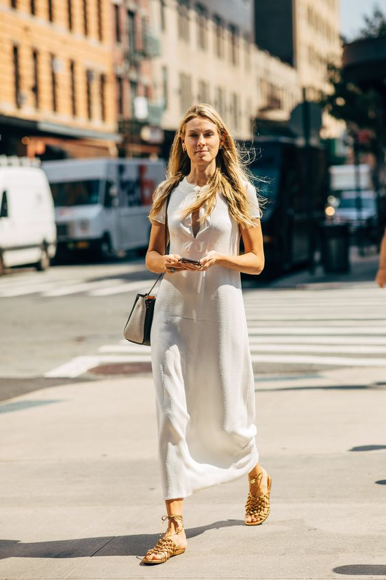 a simple white maxi dress with a cutout neckline, short sleeves, woven sandals, a two tone bag for summer