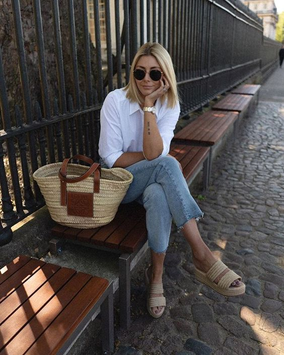 a white shirt, blue cropped jeans, woven platform slippers and a straw bag for maximal comfort
