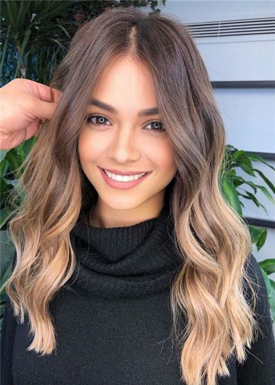 chestnut hair with lovely sunkissed blonde highlights and waves is a very chic and beautiful solution for summer