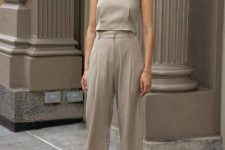 08 a grey linen suit of a spaghetti strap top and trousers, black heeled flipflops is ideal for work in summer