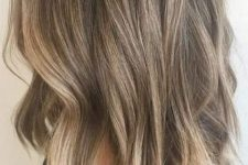 08 cold light brunette hair with blended sunkissed balayage and beachy waves is a cool and chic idea for a summer-like look