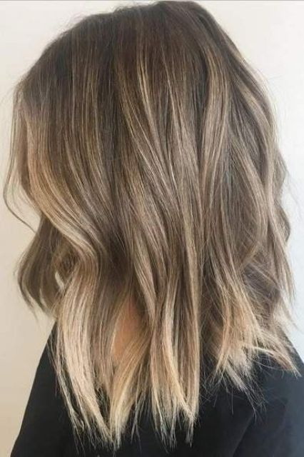 cold light brunette hair with blended sunkissed balayage and beachy waves is a cool and chic idea for a summer like look
