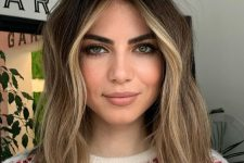 10 dark brunette hair with light sunkissed balayage and face framing higlights looks very chic and summer-inspired