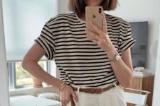 11 a striped t-shirt, white linen trousers, a brown woven belt and a large round straw bag for this summer