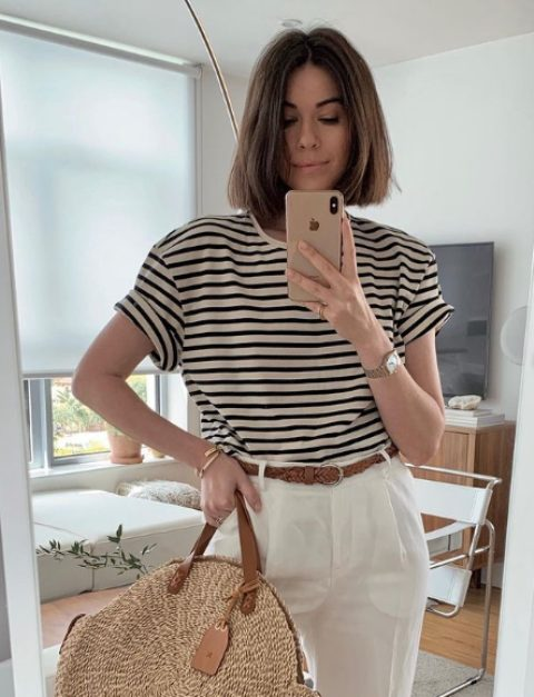 a striped t shirt, white linen trousers, a brown woven belt and a large round straw bag for this summer