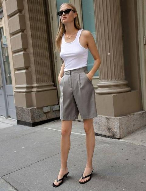 a summer outfit for a hot day - a white top and grey linen shorts plus black kitten heel flipflops