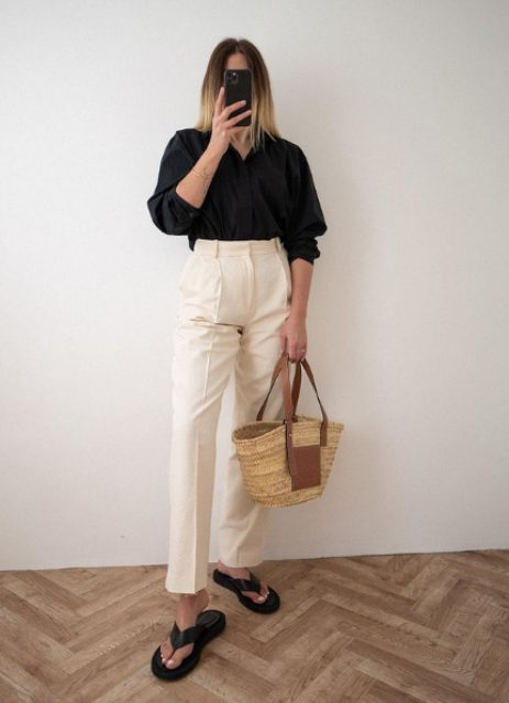 a black linen shirt, white high waisted trousers, black flipflops and a straw bag for a chic summer look