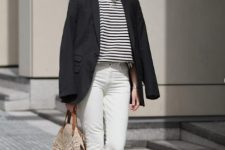 12 a stylish casual summer look with a striped tee, white cropped jeans, white sneakers, a black blazer and a round straw bag