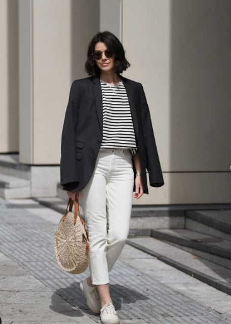 a stylish casual summer look with a striped tee, white cropped jeans, white sneakers, a black blazer and a round straw bag