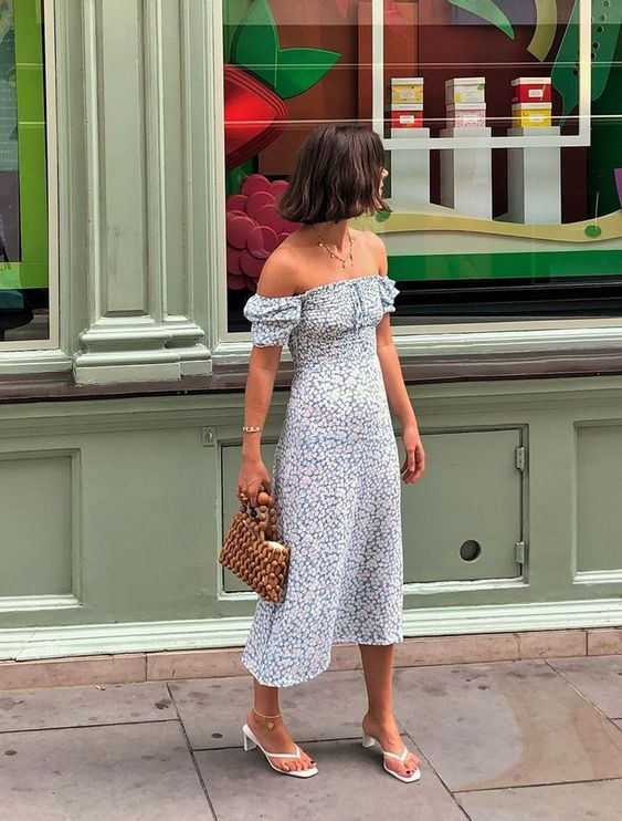 an off the shoulder blue printed midi dress, white heeled flipflops, a wooden bead bag for summer