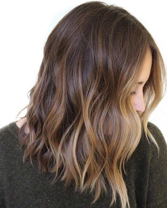 gorgeous rich brown wavy hair with chic sunkissed balayage and waves is a lovely idea to embrace the summer with your look