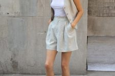 14 a summer work outfit with a grey linen suit with shorts and a waistcoat, a white top and black heeled flipflops