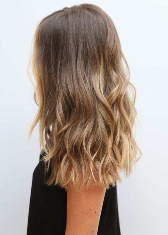 light brunette hair with beautiful sunkissed touches as if they are totally natural and are made by the sun