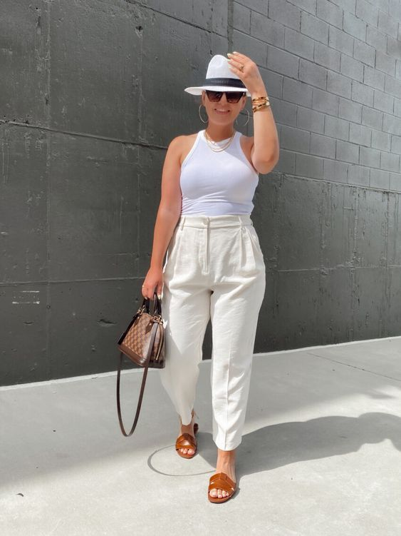 a cool hot day look with a white halter neckline top, creamy linen pants, brown slippers, a hat, layered necklaces and a chic bag
