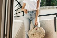 15 a white t-shirt, blue cropped jeans, espadrilles and a round straw bag for a casual and a bit girlish look