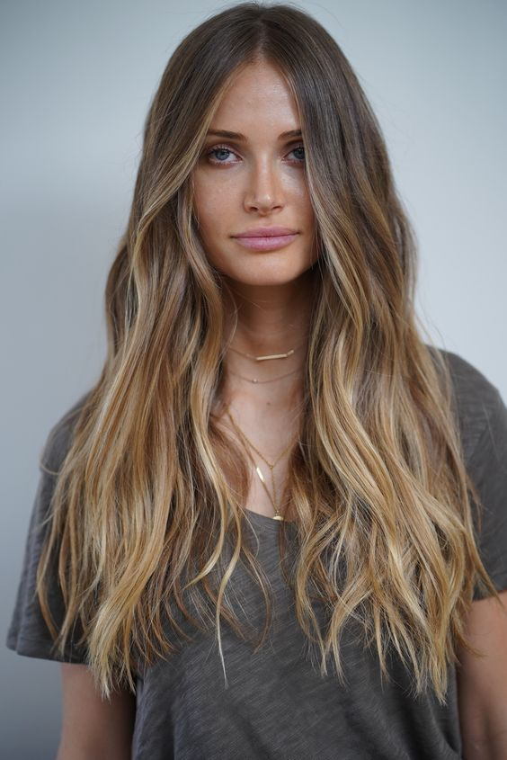 light brunette hair with long honey blonde highlights and waves is a cool idea to wear in summer