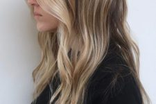 16 light brunette hair with sunkissed blonde higlights and with waves is a very actual and stylish idea