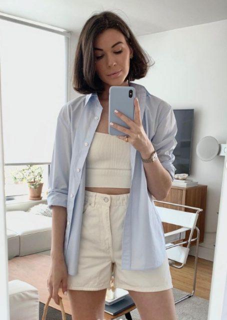a creamy crop top, matching denim shorts, a blue oversized shirt for a cool summer look