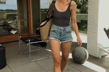 18 a black top, blue denim mini shorts, a large tote and black flipflops for an every day summer look