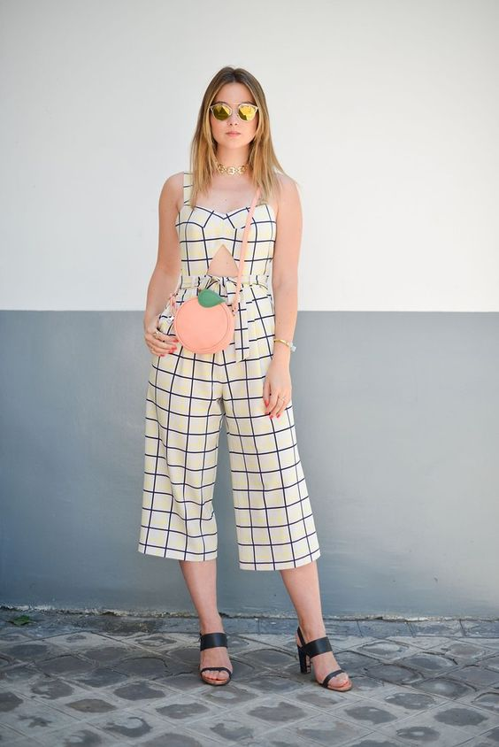 a lovely white and blue windowpane overall with a cutout, black shoes, a pink round bag and a statement necklace