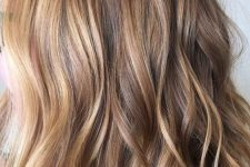 18 light brunette hair with blonde and sunkissed balayage and waves is a very cool beach-inspired option