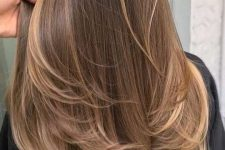 19 long brown hair with long sunkissed and mushroom blonde balayage and a bit of ombre is very cool