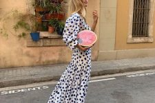 20 a midi white and navy dress with puff sleeves and yellow flipflops for a contrasting look