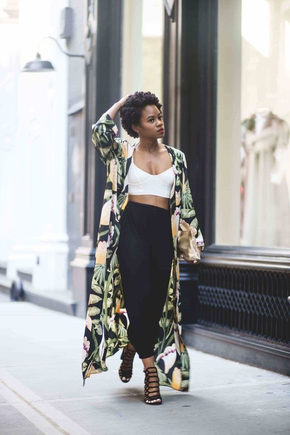 a white crop top, black high waisted pants, black laser cut shoes and a colorful leaf print kimono for a wow effect