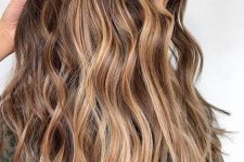 22 long wavy brunette hair with sunkissed balayage is a pretty idea for summer that doesn't require much maintenance