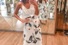 24 a white tied up top, a white midi skirt with botanical prints, white flipflops for a summer girlish look