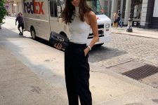 25 a white turtleneck top, black cropped trousers, a black clutch and black flipflops are a chic idea