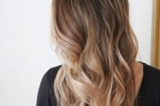 26 long sunkissed blonde with a darker root and waves is a lovely idea to embrace the summer