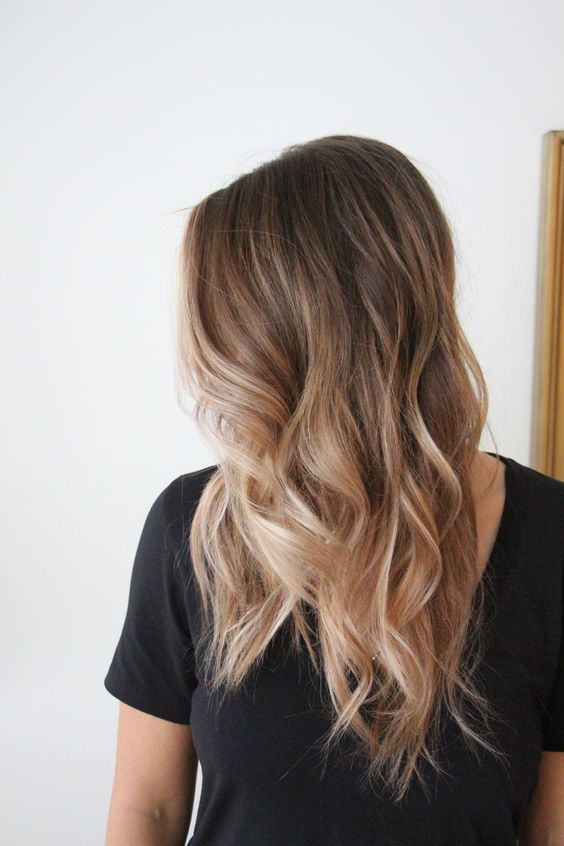 long sunkissed blonde with a darker root and waves is a lovely idea to embrace the summer
