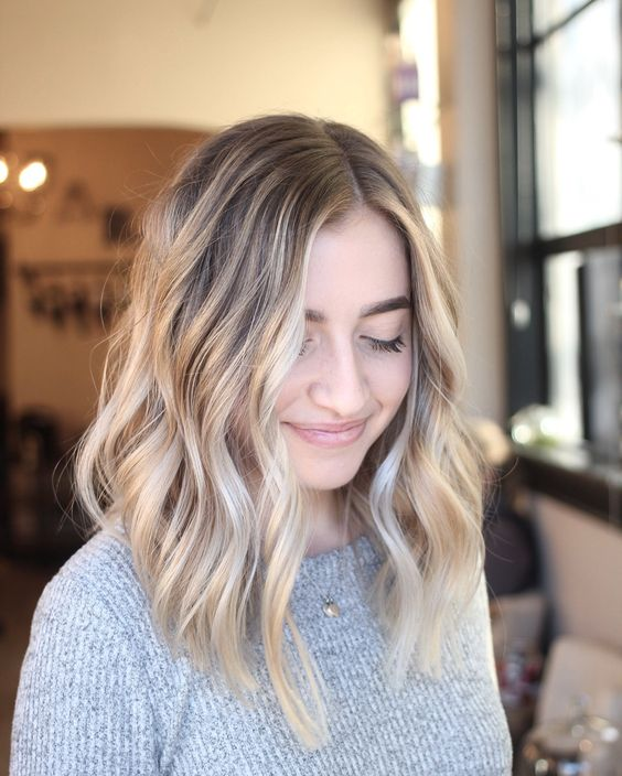 lovely sunkissed blonde with waves and a slightly darker root is a very refreshing solution for summer