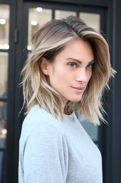sunkissed blonde hair with a darker root and a raw hem is a pretty and fresh idea to try in summer