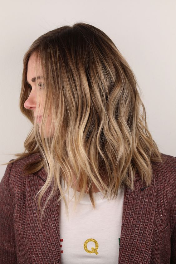 sunkissed blonde hair with a darker root and slight waves is a lovely idea for a summer and doesn't require maintenance