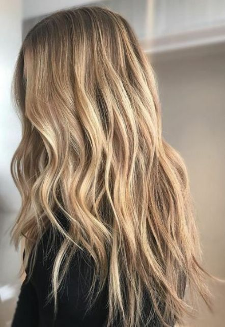 very natural and delicate long sunkissed hair with waves and a darker root is a lvoely idea for summer