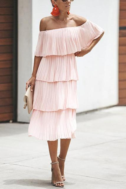 With beige ankle strap sandals and clutch