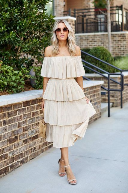 With beige bag and beige ankle strap sandals