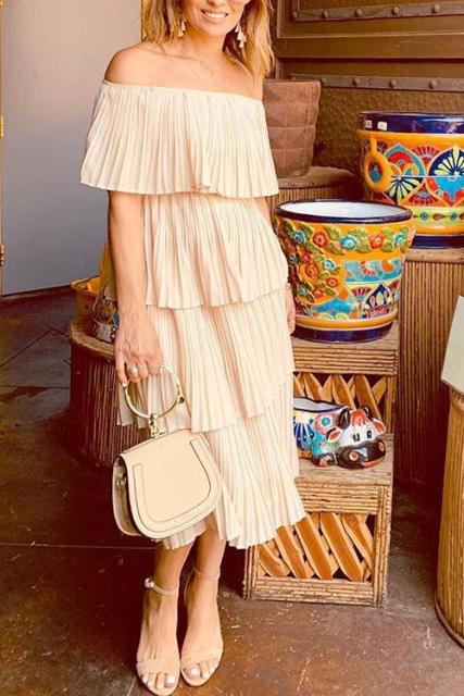 With beige bag and sandals
