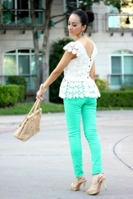 With beige bag, beige high heels and turquoise trousers
