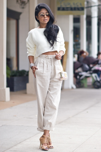 With beige loose sweater, chain strap bag and beige lace up high heels