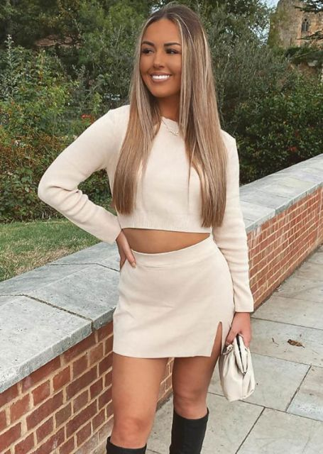 With beige mini skirt, white clutch and black high boots